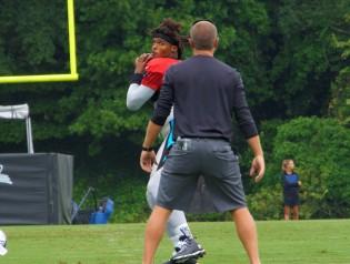 Newton throws during warm ups.